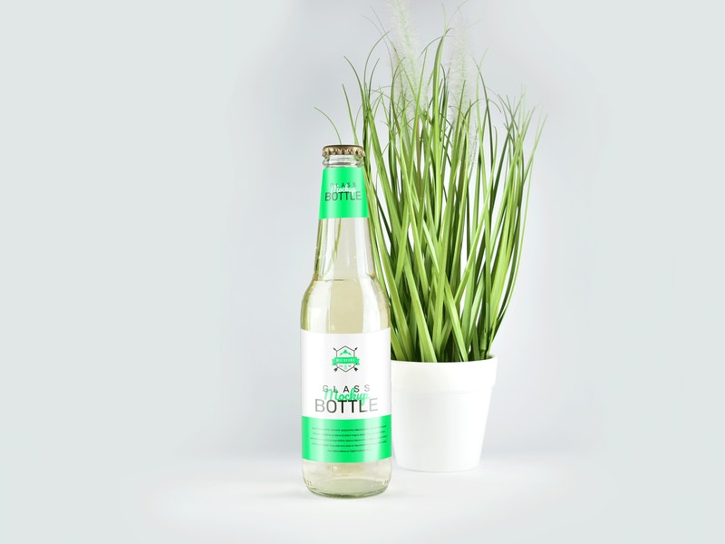 Free Clear Glass Bottle Mockup (PSD)