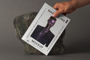 Holding Magazine Free Mockup