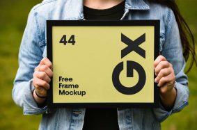 Free Girl Holding Poster Frame Mockup