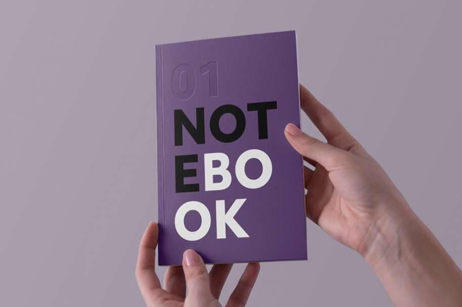 Free Holding Notebook Mockup
