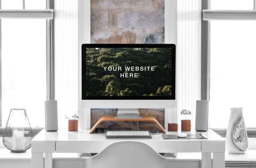 Free iMac 27″ in Desk Mockup