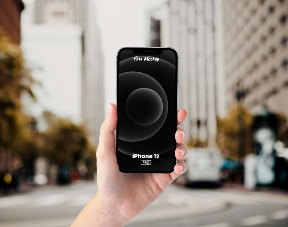 Holding iPhone 12 Pro Free PSD Mockup