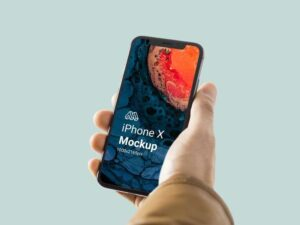 Free iPhone X in Hand Mockup