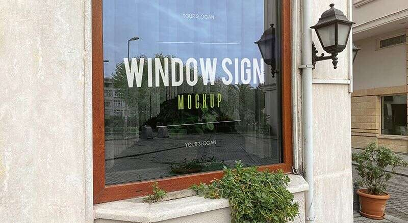 2 Free Window Sign in a Restaurant Mockups