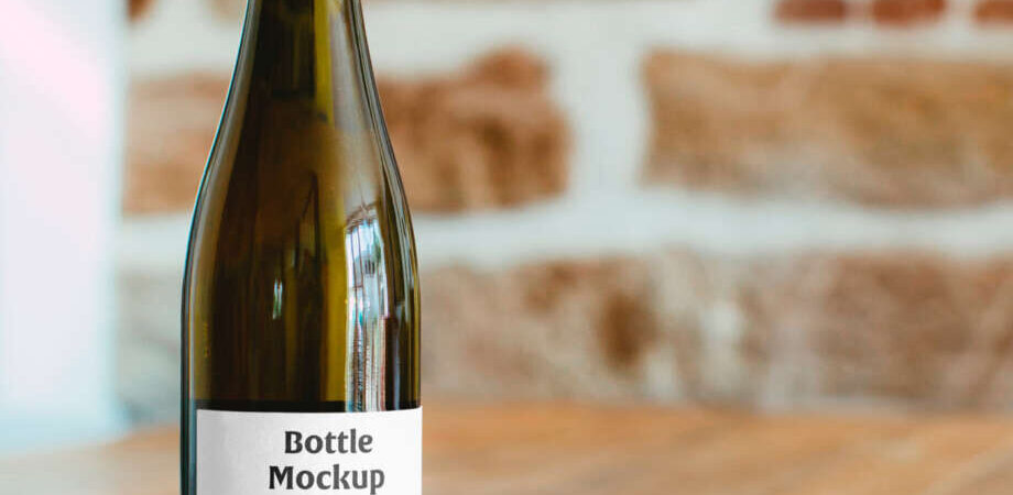Free Wine Bottle on Table Mockup