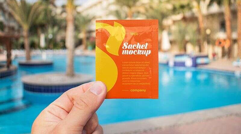 Free Sachet in a Hand Mockup