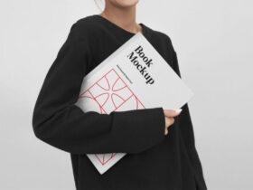 Free Woman Holding Book Mockup