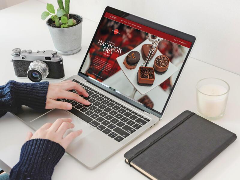 Free Person Using MacBook Pro Mockup PSD