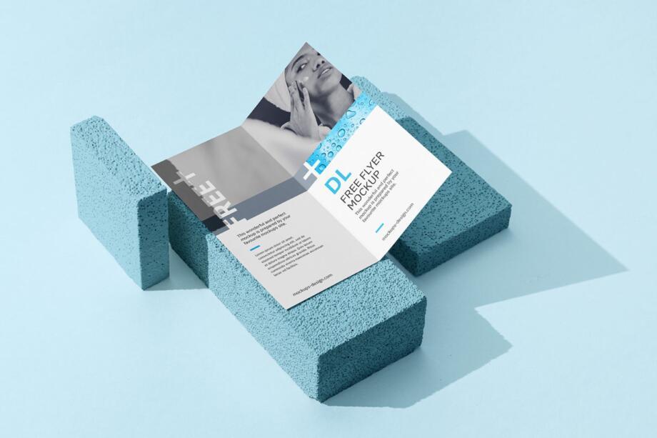 Free Bi fold DL Flyer on a Stone Mockup PSD Template