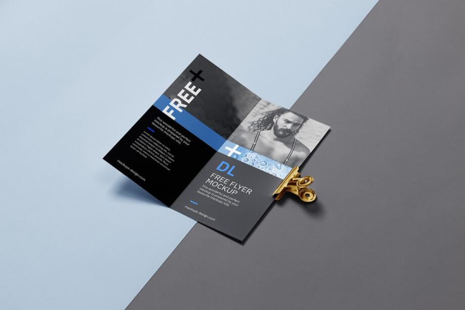Free Bi fold DL Flyer with a Clip Mockup PSD