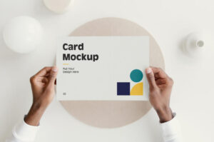 Free Card with Hands Mockup PSD Template