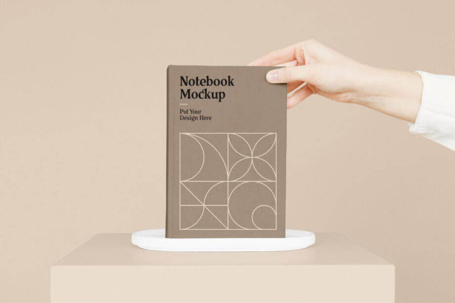 Free Notebook with Hand Mockup PSD Template